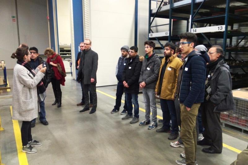 Vluchtelingen op bedrijfsbezoek in Tielt